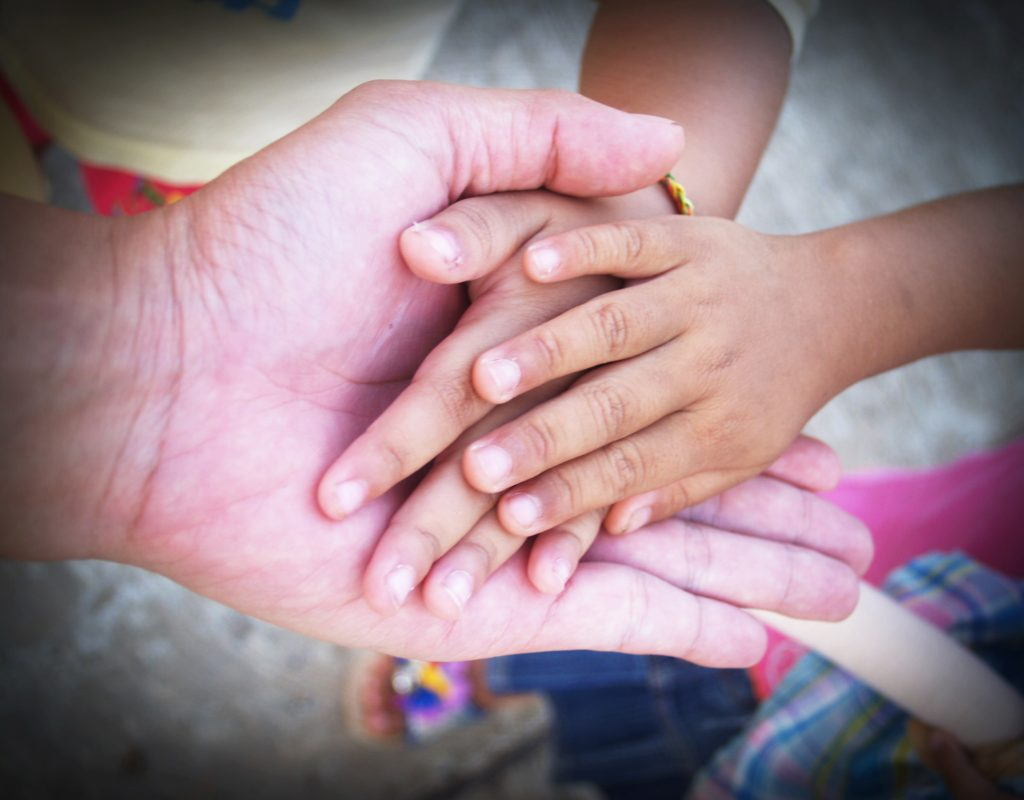 adult and child's hands